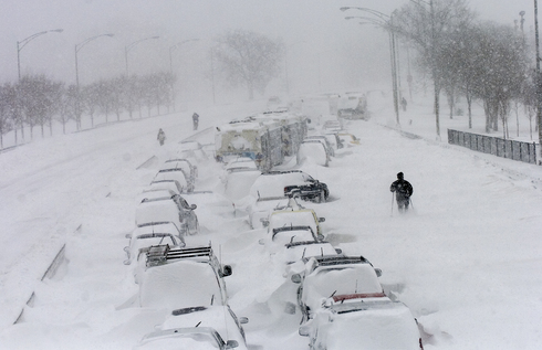 A man snowshoes by cars stuck in the northbound lanes of Lake Shore Drive near North Avenue after they were trapped by snow in Chicago, IL on Wednesday February 2, 2011 | Matt Marton~Sun-Times Media